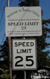 Signage reminds drivers of neighborhood speed watch program. Speed limit is 25 MPH.